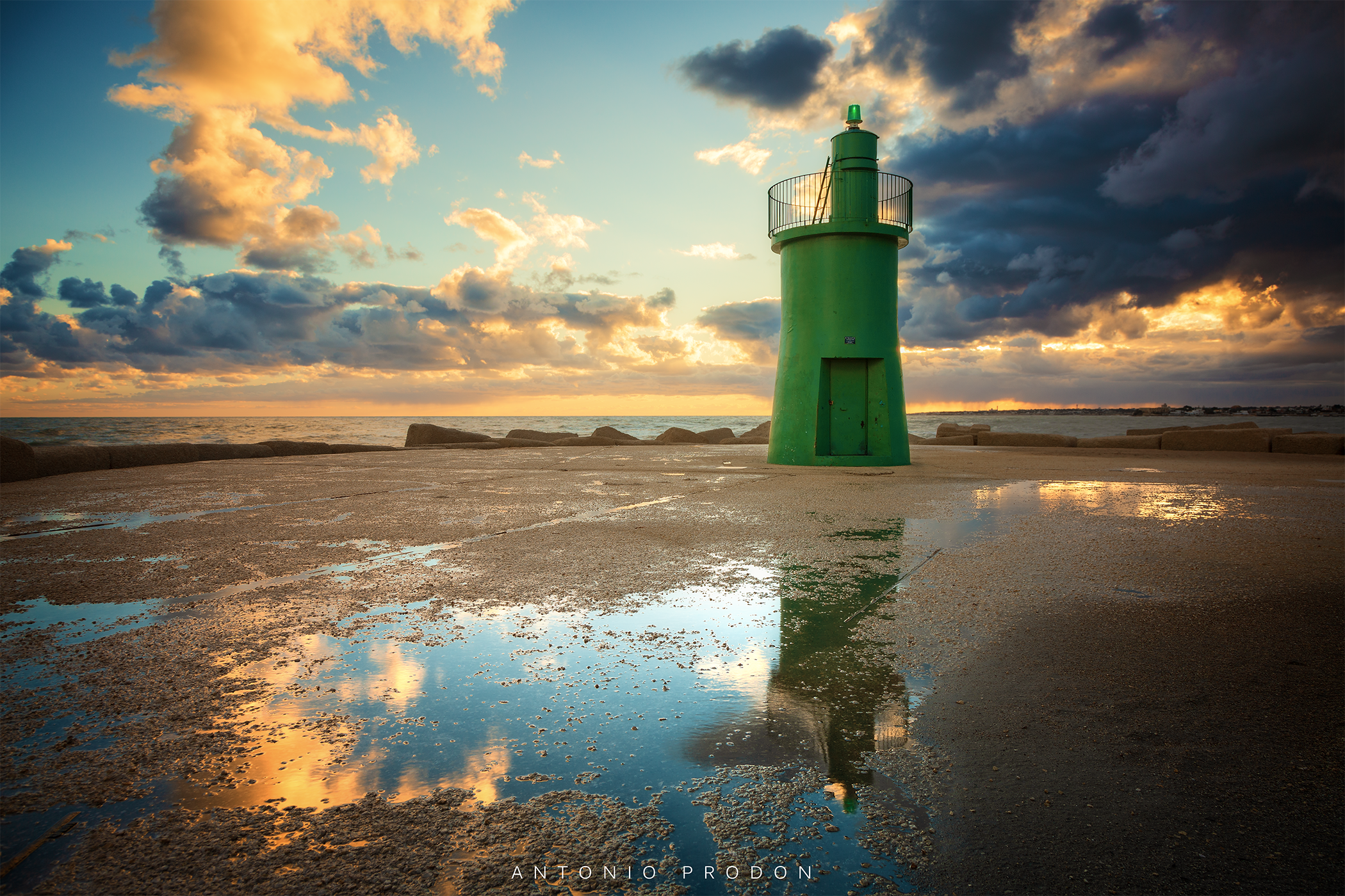 The Green Lighthouse placed in Trani dunring the first sunrise of the 2019 year.